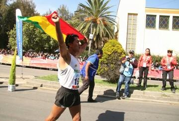 Ronal Quispe se baña de bronce en marcha masculina