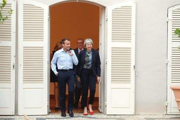 """May busca apoyo en Francia para plan del """"brexit"""""""