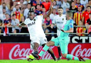 Valencia y Atlético igualan en su debut en la Liga española