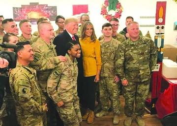 Trump insiste en muro con México en visita a Irak
