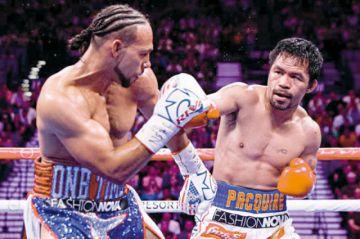 Pacquiao ganó la corona welter con 40 años