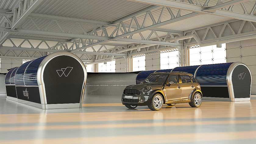 El prototipo Watly 3.0 en construcción ante un auto para comprobar sus dimensiones.