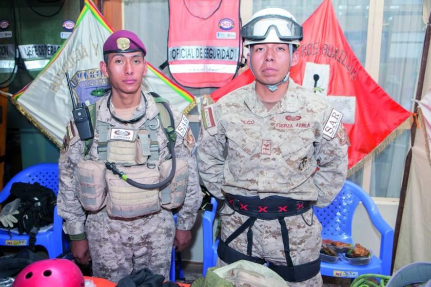 Russel Cardozo y Erick Pilco (rescatistas SAR-FAB).