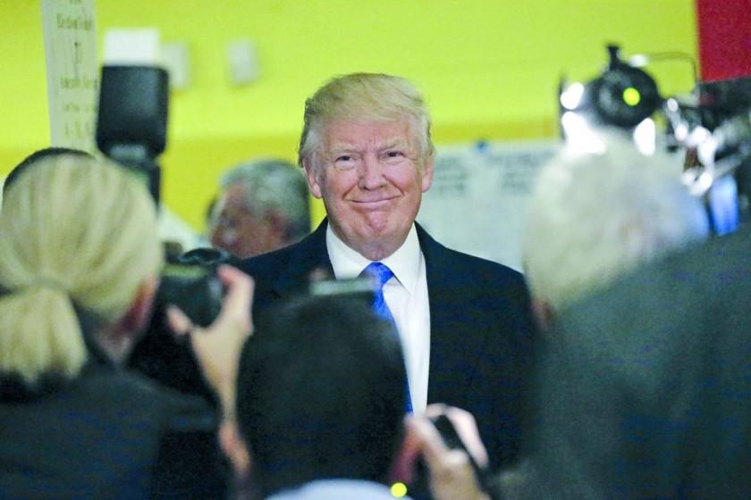 VOTACIÓN. El candidato republicano, Donald Trump, sonríe tras votar en la ciudad de Nueva York en las elecciones...