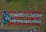 Logran la bandera más grande de Puerto Rico del mundo sobre 250 automóviles