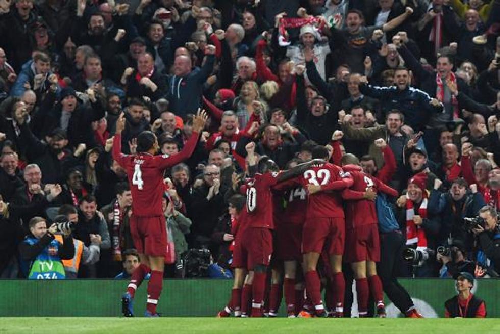 Los jugadores del Liverpool celebran uno de los goles que les llevó a la victoria en la  semifinal de la UEFA Champions League.